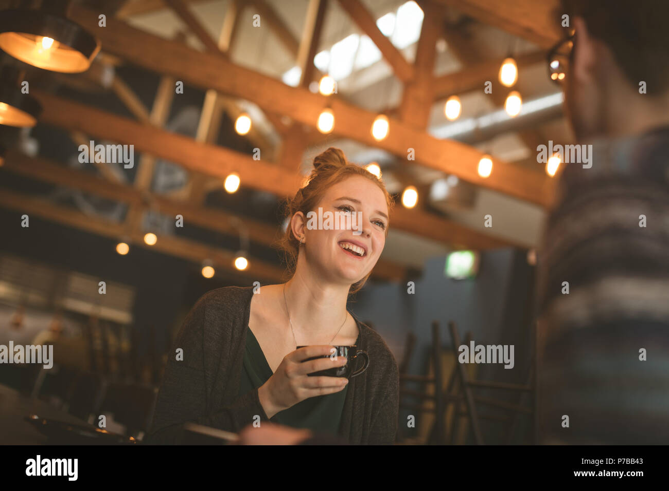 Couple having coffee at the counter - Stock Image
