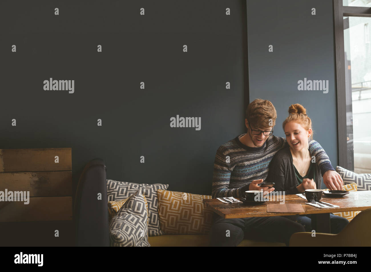 Couple talking to each other in cafe - Stock Image