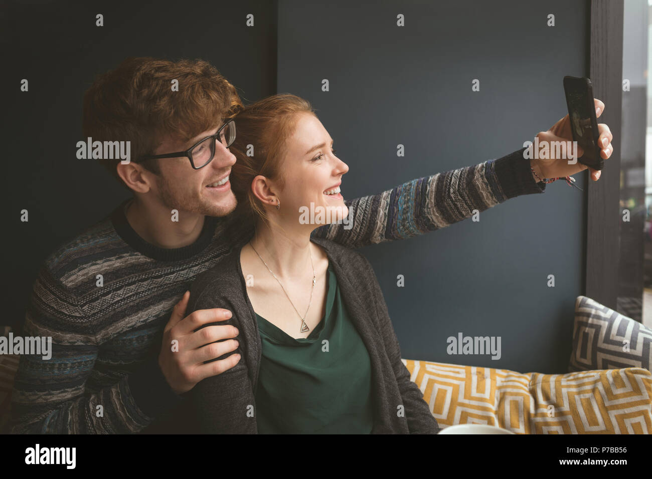 Couple taking a selfie in the cafe - Stock Image
