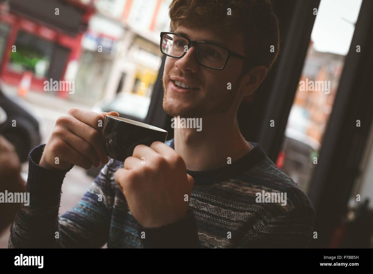 Man having coffee in cafe Stock Photo