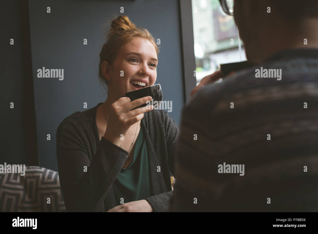 Smiling couple having coffee at the cafe - Stock Image