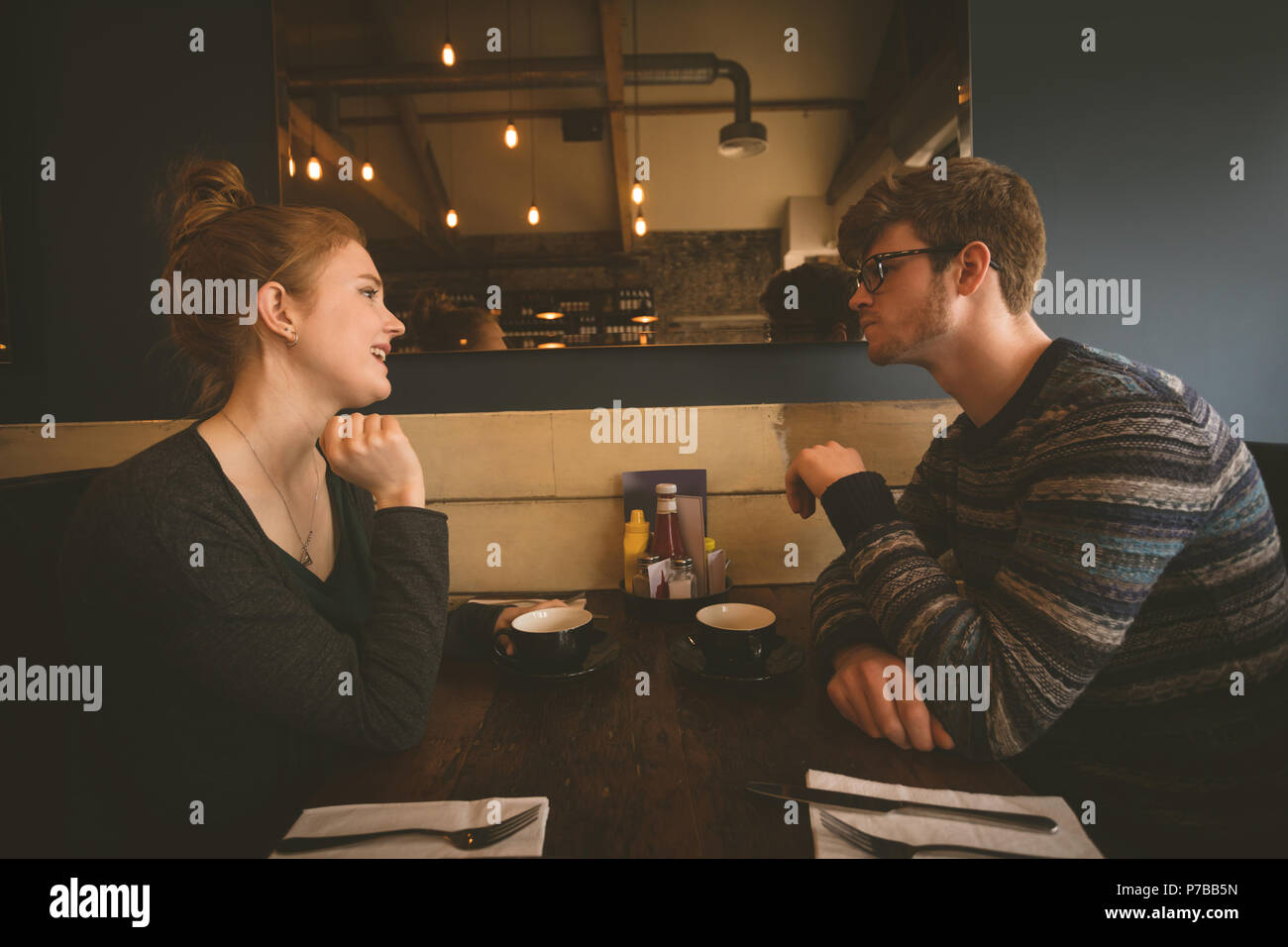 Couple talking to each other at the restaurant Stock Photo