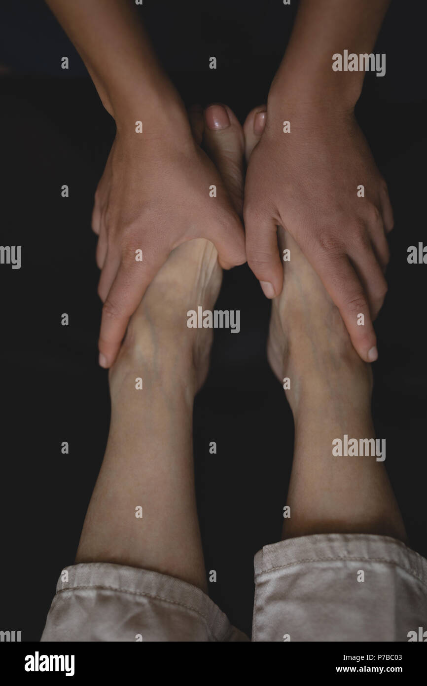 Physiotherapist giving a leg massage - Stock Image