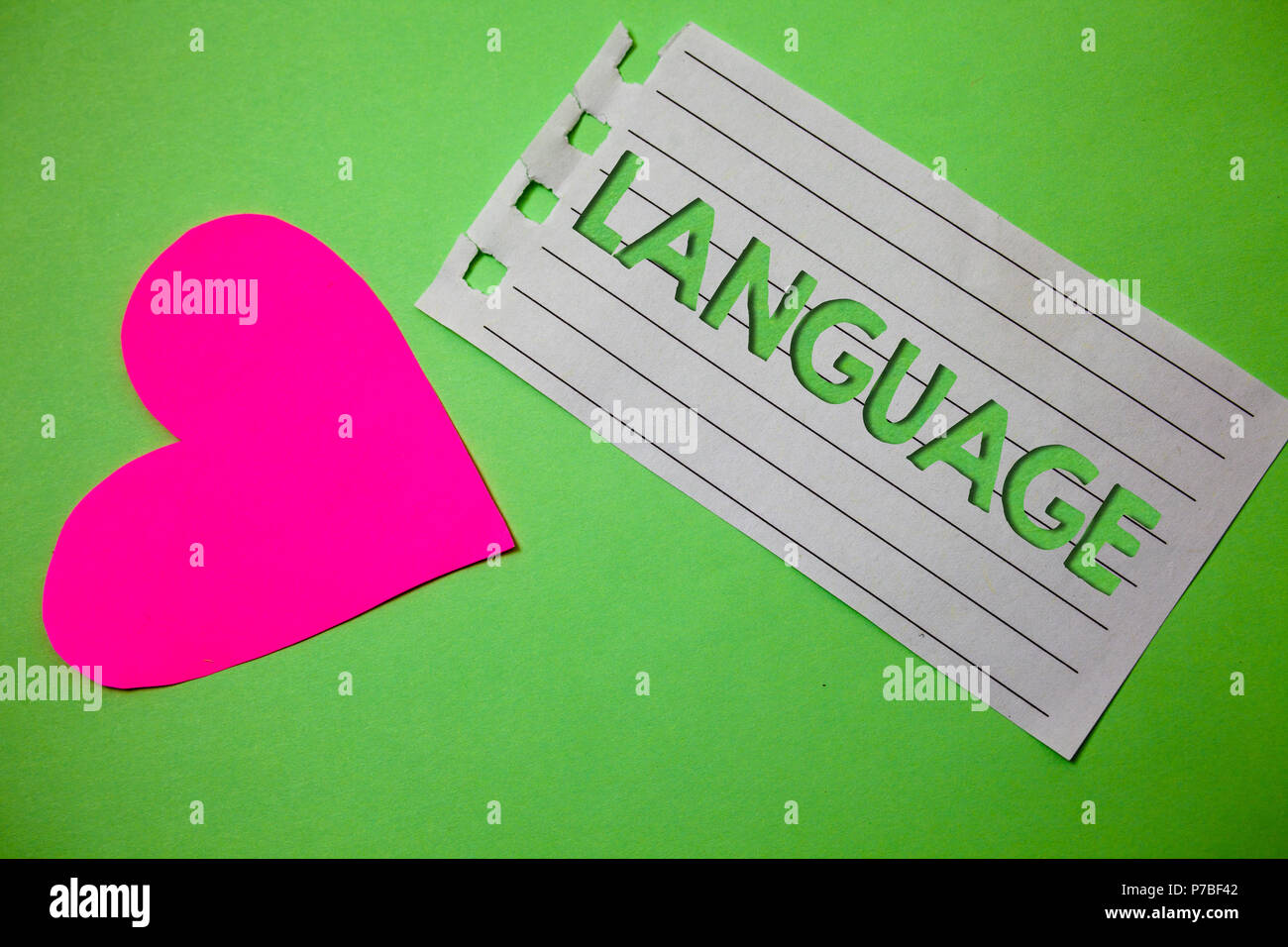 Conceptual hand writing showing Language. Business photo showcasing Method of human communication Spoken Written Use Words Expression Small paper draw - Stock Image