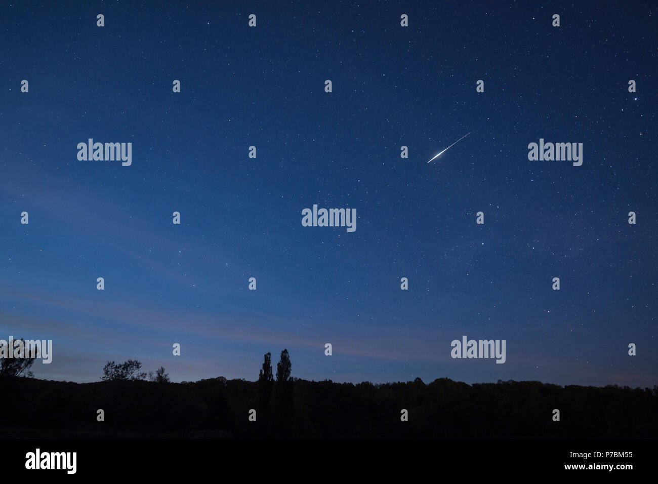 Iridium Flare, Satellite Iridium 81, May 17th, 2017, Steinertsee, Natural park Frau-Holle-Land, Hesse, Germany Stock Photo
