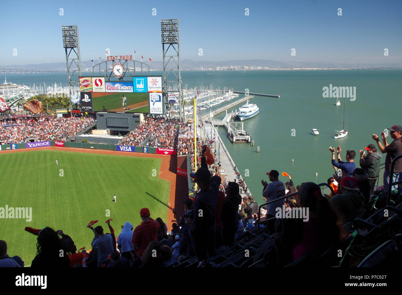 AT&T Park, a San Francisco Giants baseball game; the crowd applauds a home run. - Stock Image