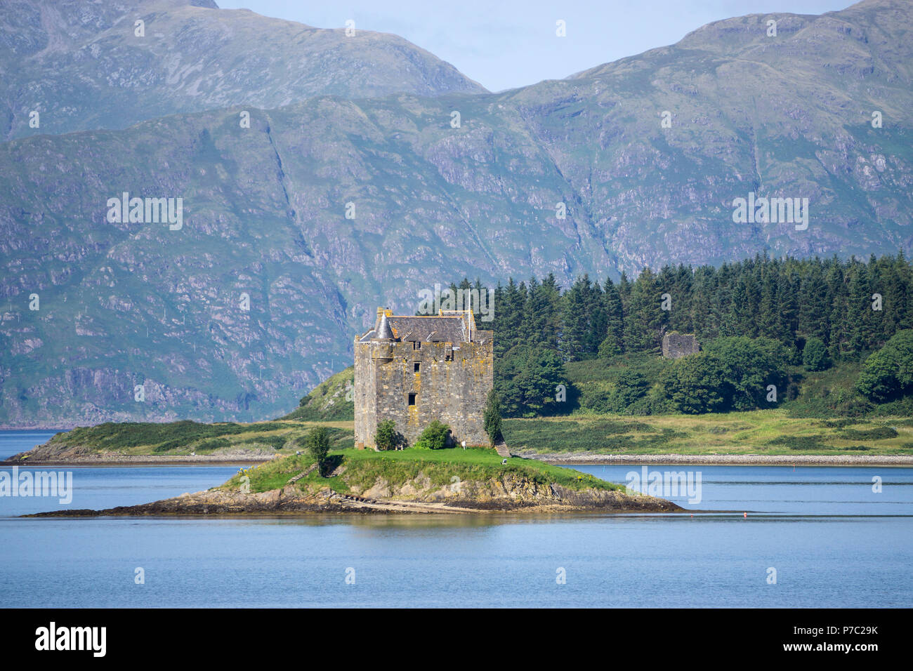 Castle Stalker (Caisteal an Stalcaire) is a four-storey tower house or keep picturesquely set on a tidal islet on Loch Laich, an inlet off Loch Linnhe - Stock Image