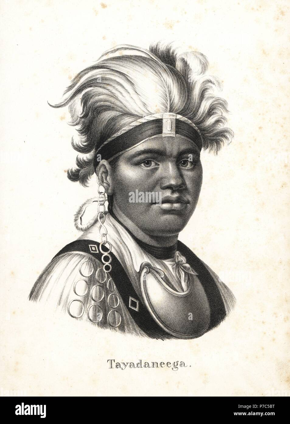 Tayadaneega, Thayendanegea or Joseph Brant (1743-1807), Mohawk chief and leader. He wears a feather headdress, metal gorget, shirt, and chain earring. Lithograph by Karl Joseph Brodtmann from Heinrich Rudolf Schinz's Illustrated Natural History of Men and Animals, 1836. - Stock Image