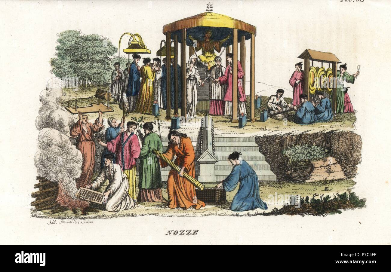Japanese wedding ceremony. A monk presides over the marriage in a shrine to the goddess of virginity while musicians play on gongs and koto harp, and the bride's childish ornaments are burnt on a pyre. Handcoloured illustration and copperplate engraving by Andrea Bernieri from Giulio Ferrrario's Costumes Antique and Modern of All Peoples (Il Costume Antico e Moderno di Tutti i Popoli), Florence, 1842. - Stock Image