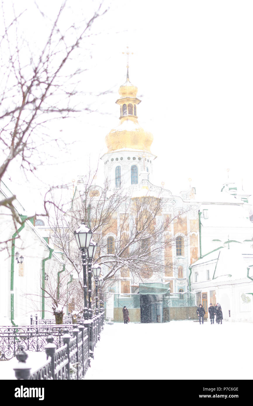 Entrance gate of the Pechersk Lavra in Kiev, Ukraine. The Gate Church of the Trinity in winter snow Stock Photo