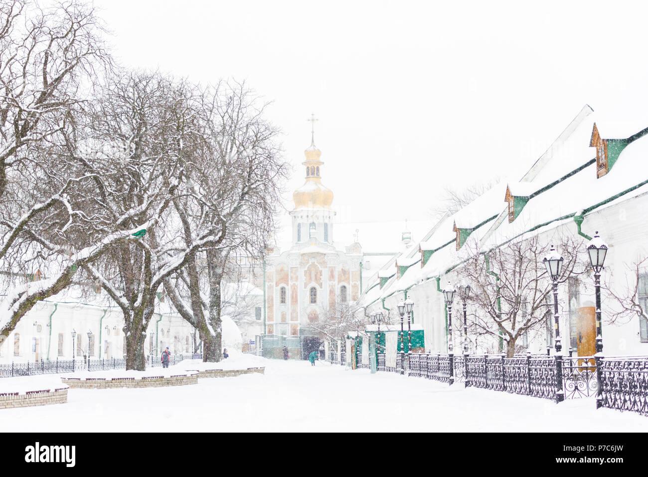 Entrance gate of the Pechersk Lavra in Kiev, Ukraine. The Gate Church of the Trinity in winter snow Stock Photo