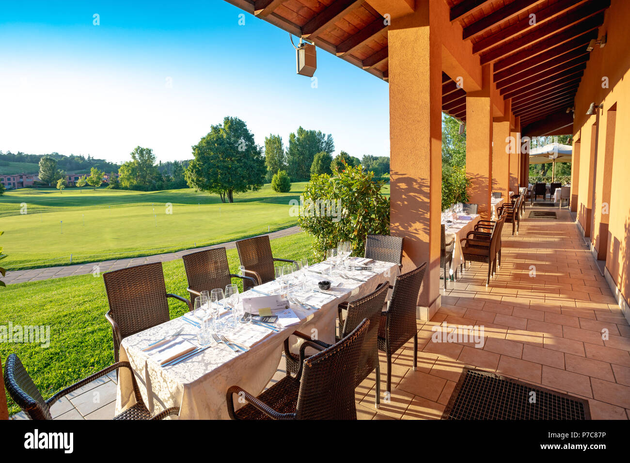 Outdoor restaurant terrace on golf club Le Fonti in Castel San Pietro Terme, Italy - Stock Image