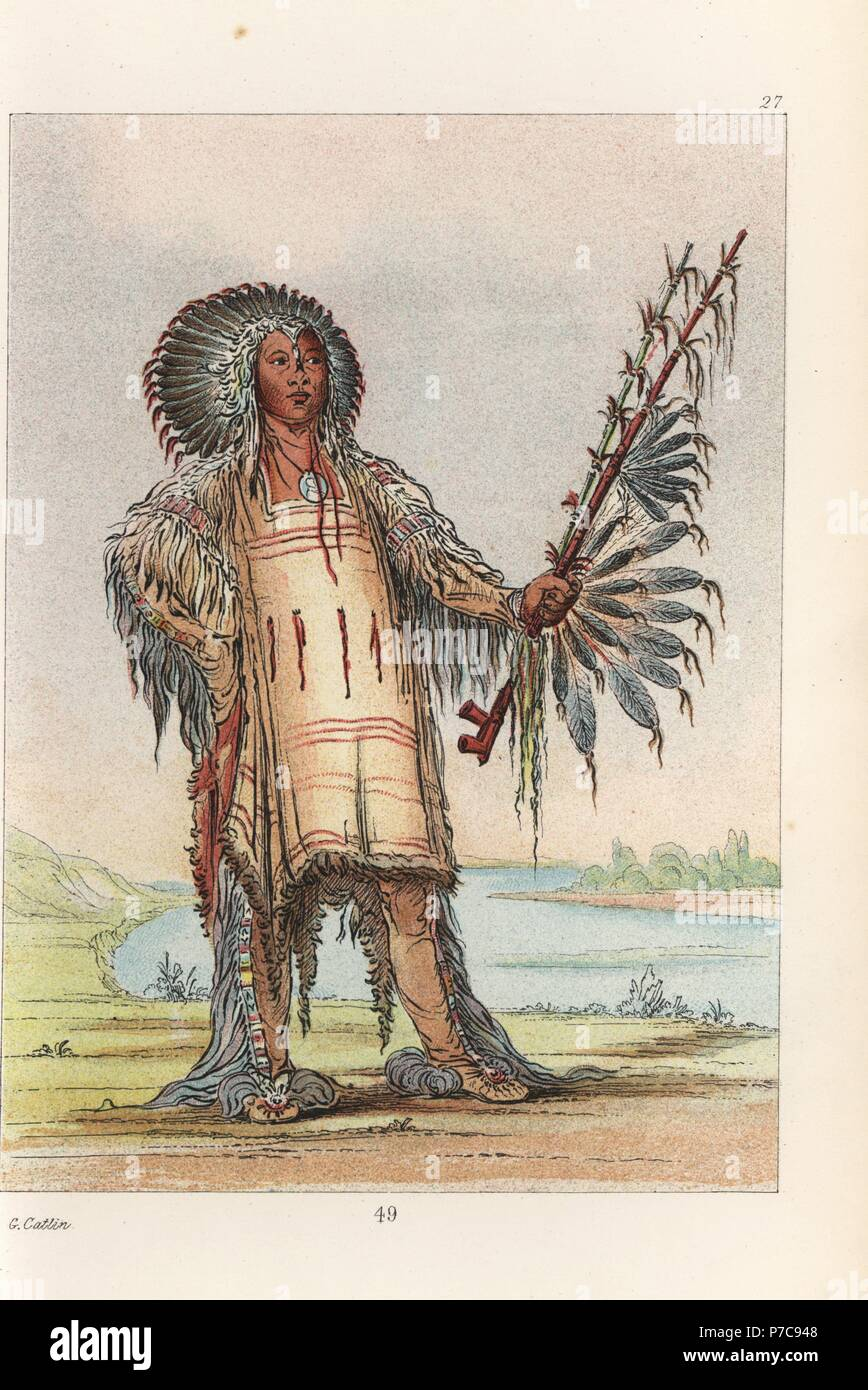 Ha-na-tah-nu-mauh, Wolf Chief, head chief of the Mandan people, in dress of skins and headdress of raven quills. Handcoloured lithograph from George Catlin's Manners, Customs and Condition of the North American Indians, London, 1841. - Stock Image