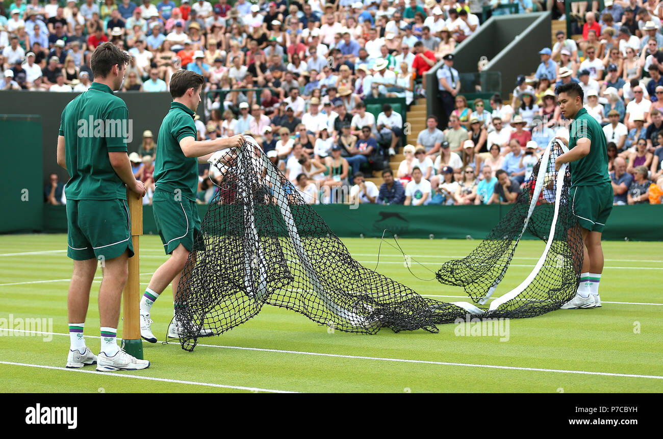 the best attitude 45a4f 26ca7 Grounds staff prepare the net on court 3 ahead of play on day four of the Wimbledon  Championships at the All England Lawn Tennis and Croquet Club, ...