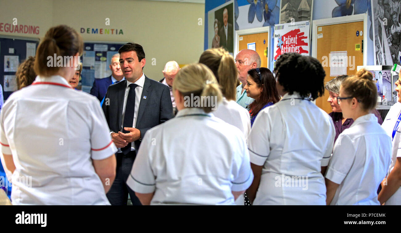 Mayor of Greater Manchester Andy Burnham talks to staff at Trafford General Hospital in Manchester to mark the 70th anniversary of the NHS. - Stock Image