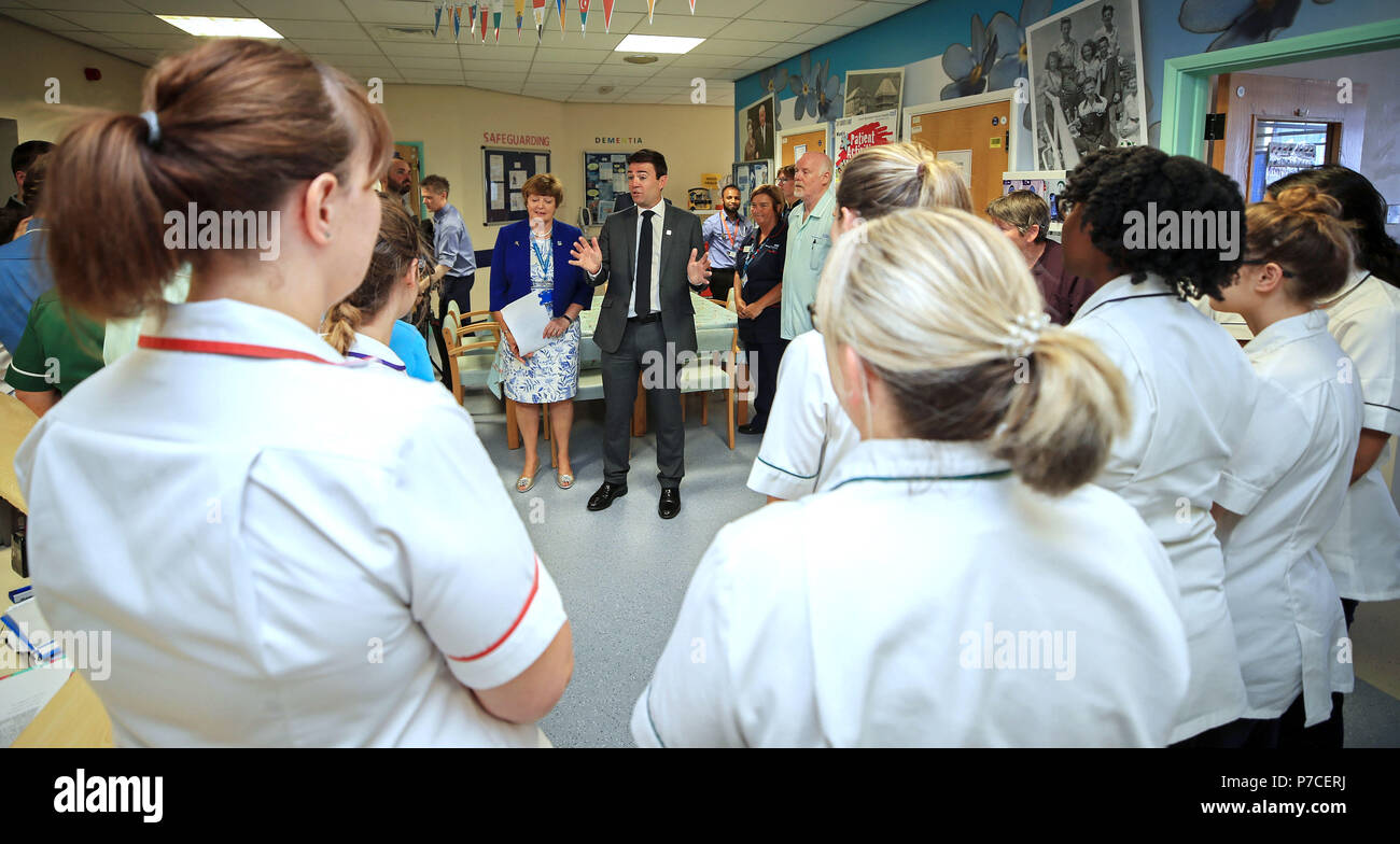 Mayor of Greater Manchester Andy Burnham talks to staff during his visit to Trafford General Hospital in Manchester, to mark the 70th anniversary of the NHS. - Stock Image