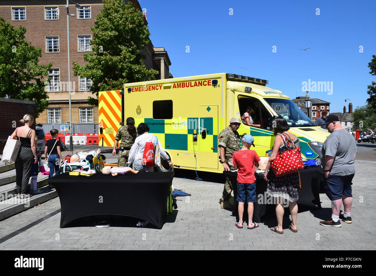 NHS 70th birthday event in central Norwich, June 2018 UK. Event co-incided with Armed Forces Day so soldiers were present to demonstrate the ambulance - Stock Image