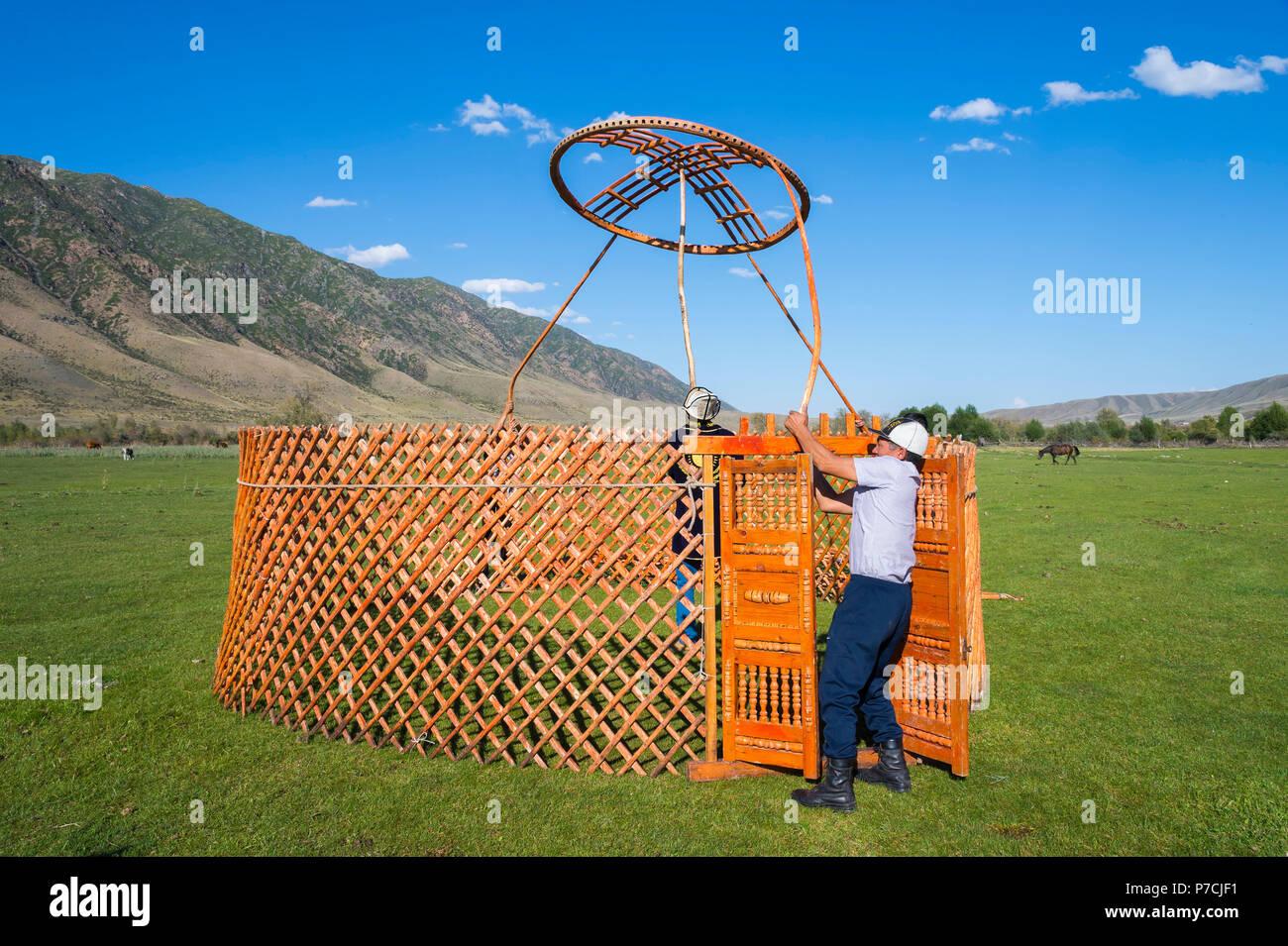 Kazakh men putting up a yurt, For editorial Use only, Sati village, Tien Shan Mountains, Kazakhstan - Stock Image