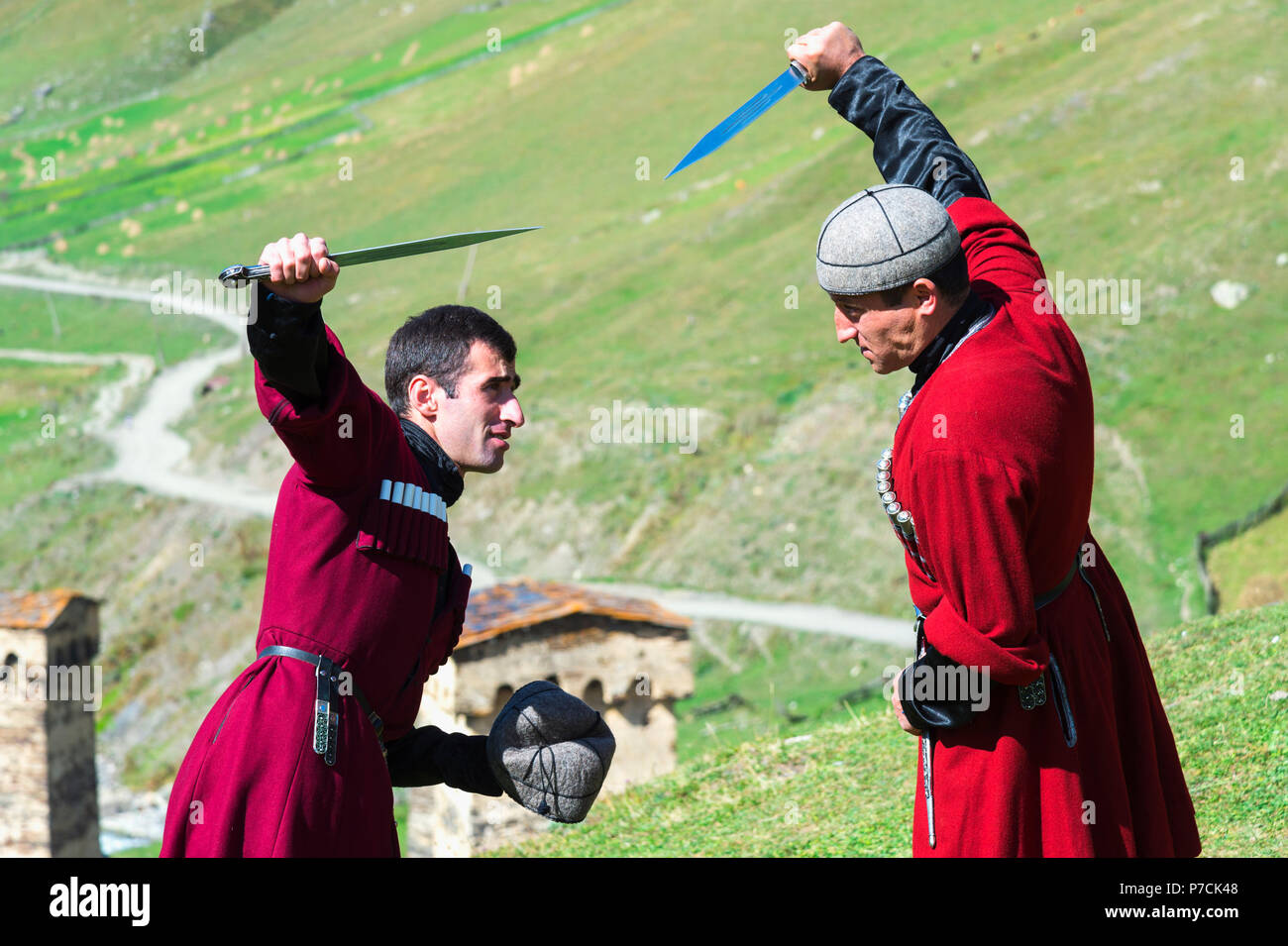 Dagger fighting show by two Georgian men of a folkloric group, Ushguli, Svaneti region, Georgia - Stock Image