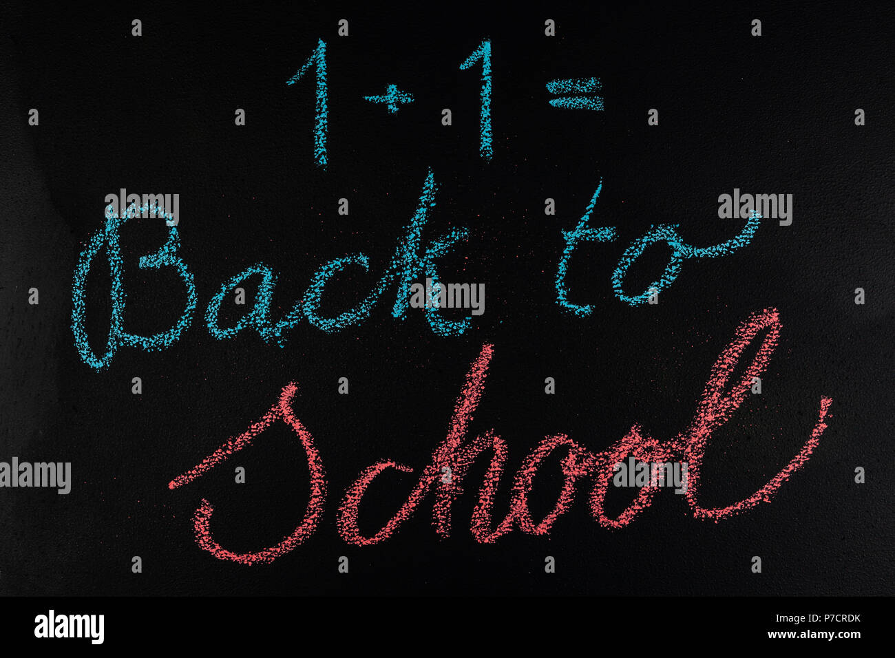 Back to school hand written with colorful chalk on blackboard - education concept Stock Photo
