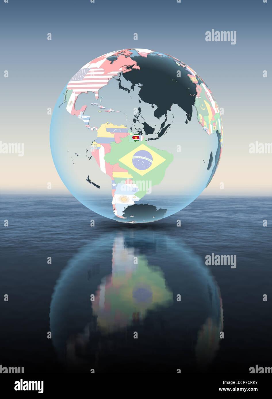 Suriname on political globe floating above water. 3D illustration. - Stock Image