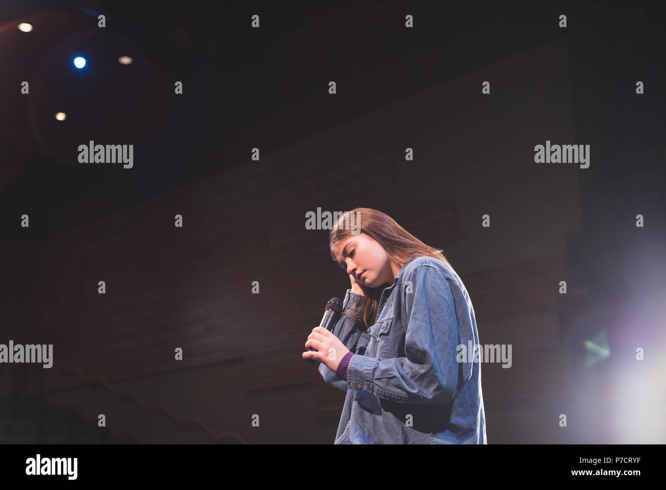 Female singer performing on stage - Stock Image