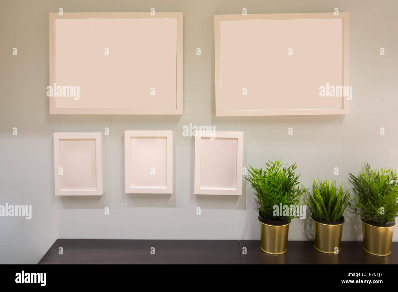 Five picture frames arranged on a wall with copy space - Stock Image