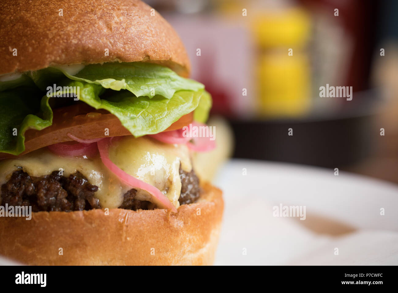 Burger served in a plate - Stock Image