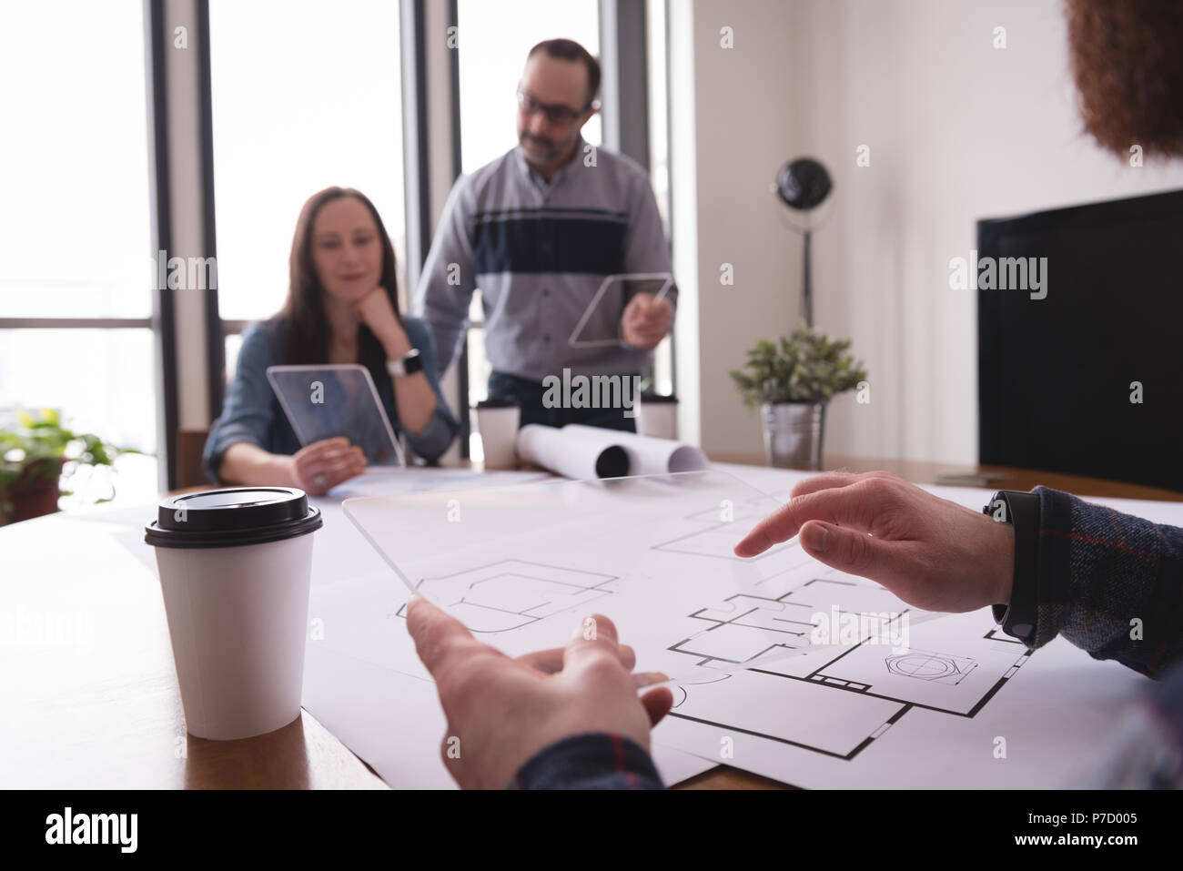 Business colleagues using glass digital tablet Stock Photo