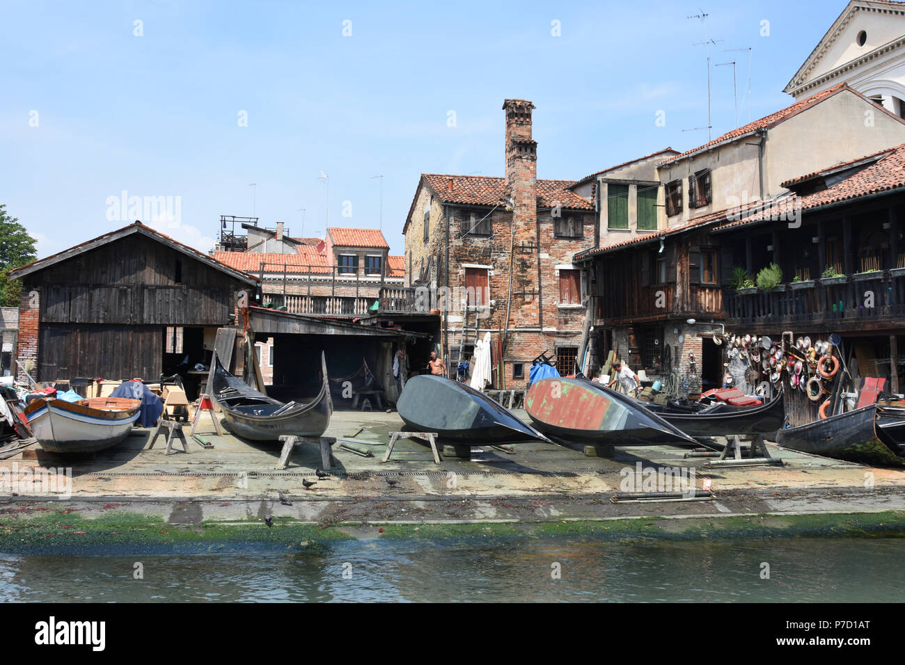 Typical Venetian shipyard where boats of small dimensions are created, built and repaired like gondolas, pupparini, sandoli, sciopòni and other boats typical of the Venetian lagoon tradition. (The squero di San Trovaso rises along the homonymous river and dates back to before the 17th century.) Painting same Location Venice, Venetian, Italy, Italian, - Stock Image