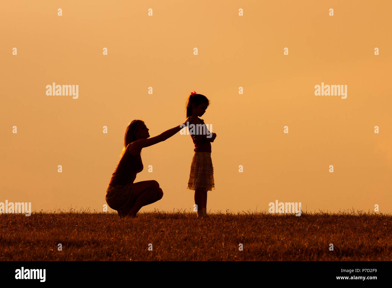Mother and daughter had a conflict and now mother consoling her angry daughter. - Stock Image
