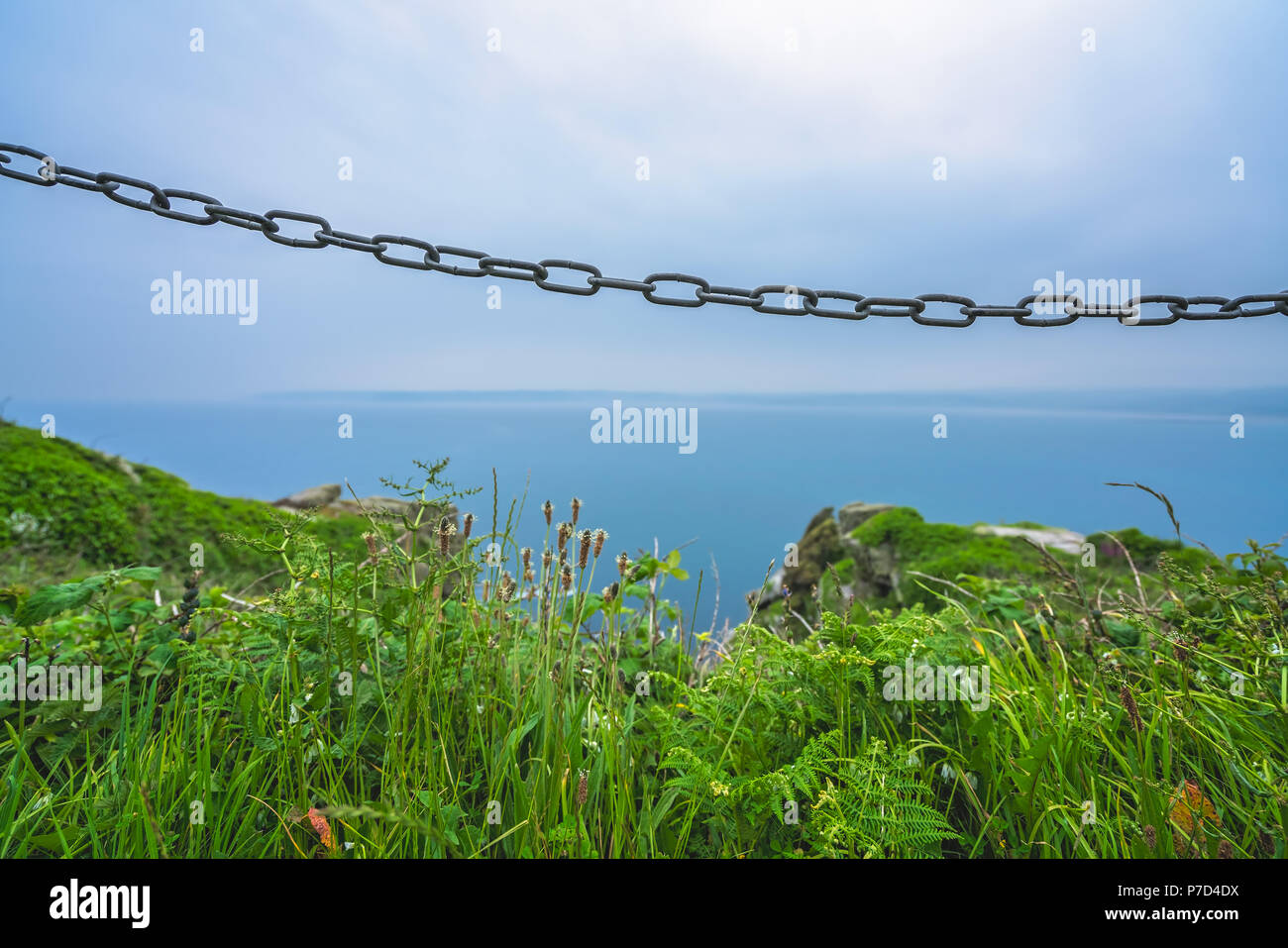 Metal chain blocking access to the dangerous and steep cliffs on the ...