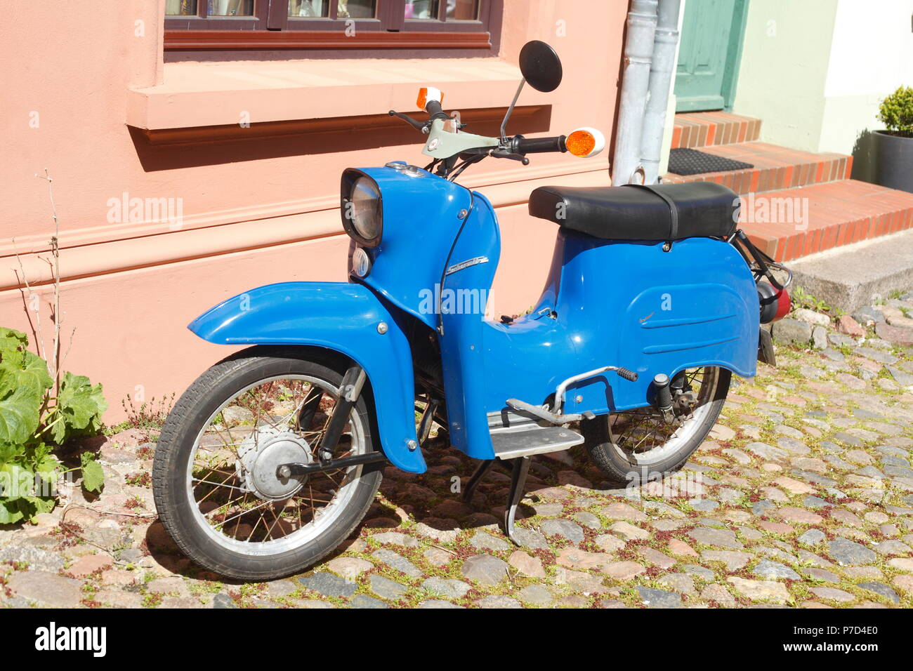 Blue Swallow GDR Scooter, Old Town, Wismar, Mecklenburg-Western Pomerania, Germany - Stock Image