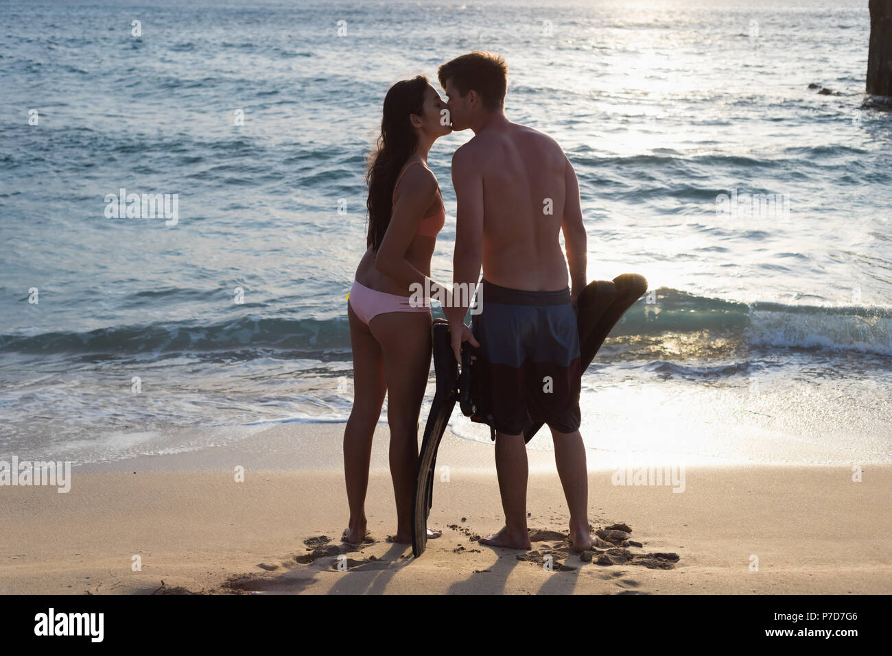Couple kissing each other on the beach Stock Photo
