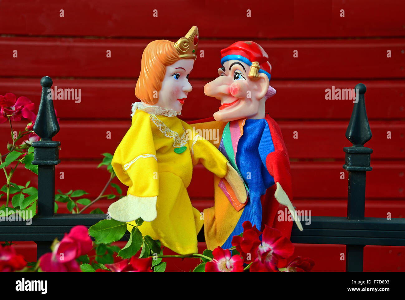 Punch puppets, Punch and Judy, princess, sitting on a metal fence - Stock Image