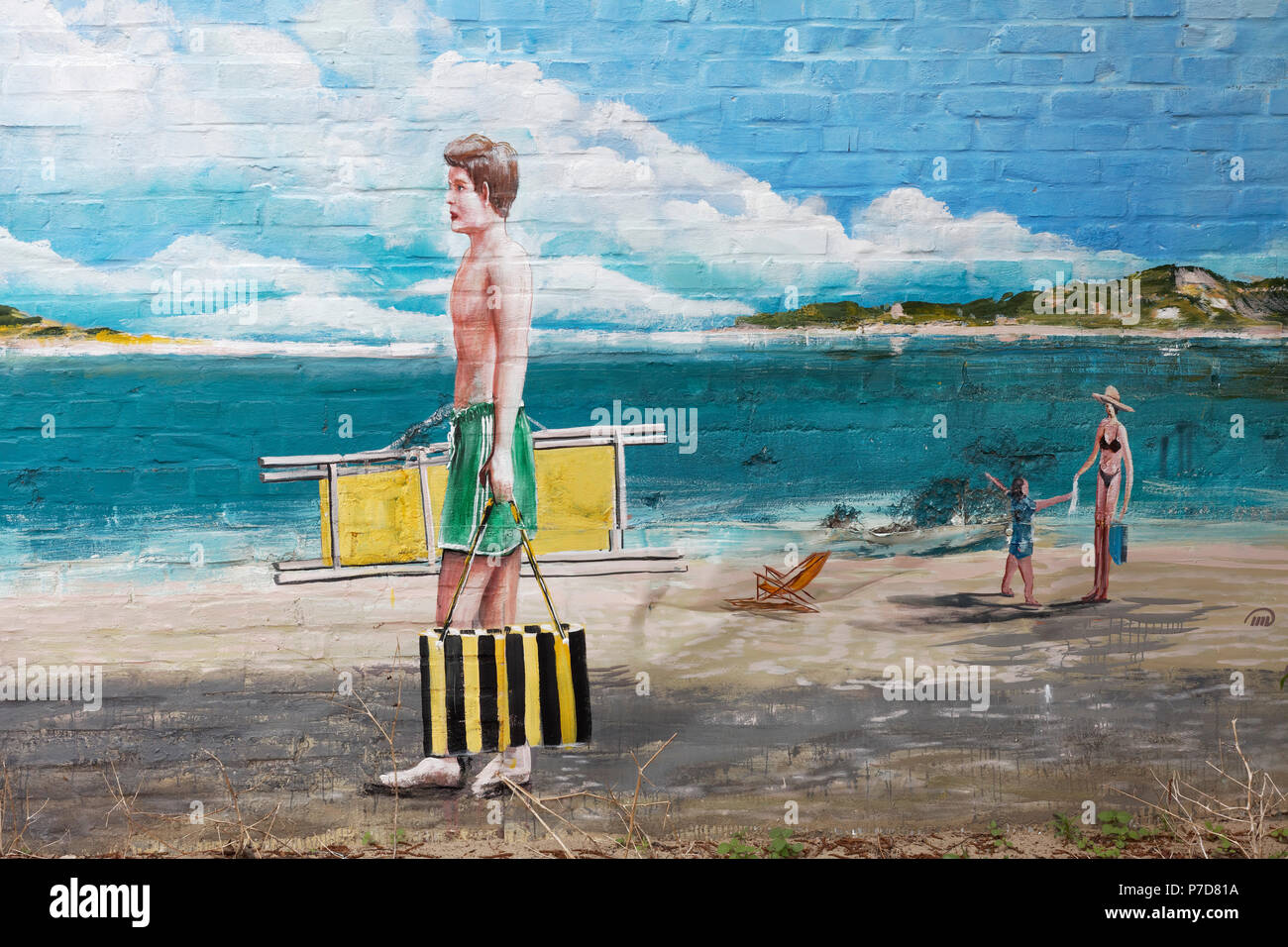 Man in swimming trunks going to the beach, Trompe L'oeil wall painting by Gregor Wosik and Danila Shumelev, Streetart - Stock Image