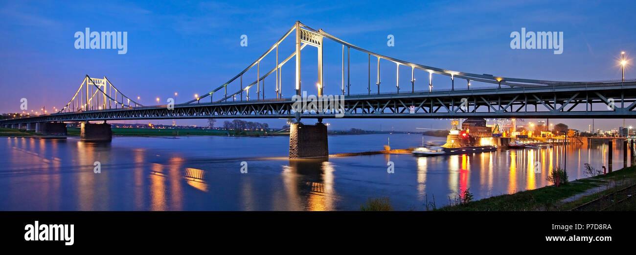 Rhine bridge between Duisburg-Mündelheim and Krefeld-Uerdingen with Rhine harbour in the evening, Krefeld - Stock Image
