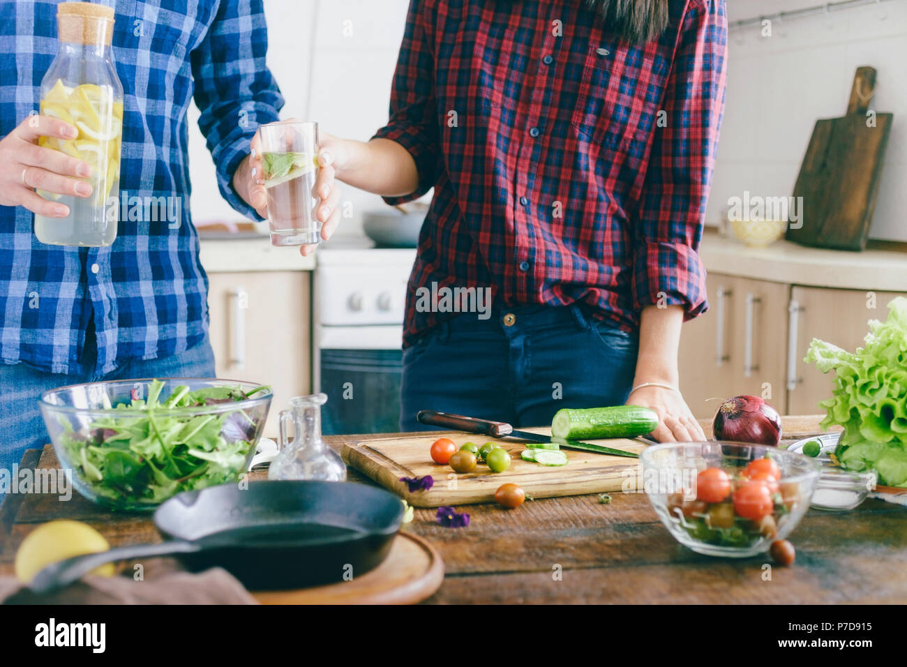 Couple Is Preparing Healthy Light Dinner At Home In The Kitchen. Healthy  Food Concept