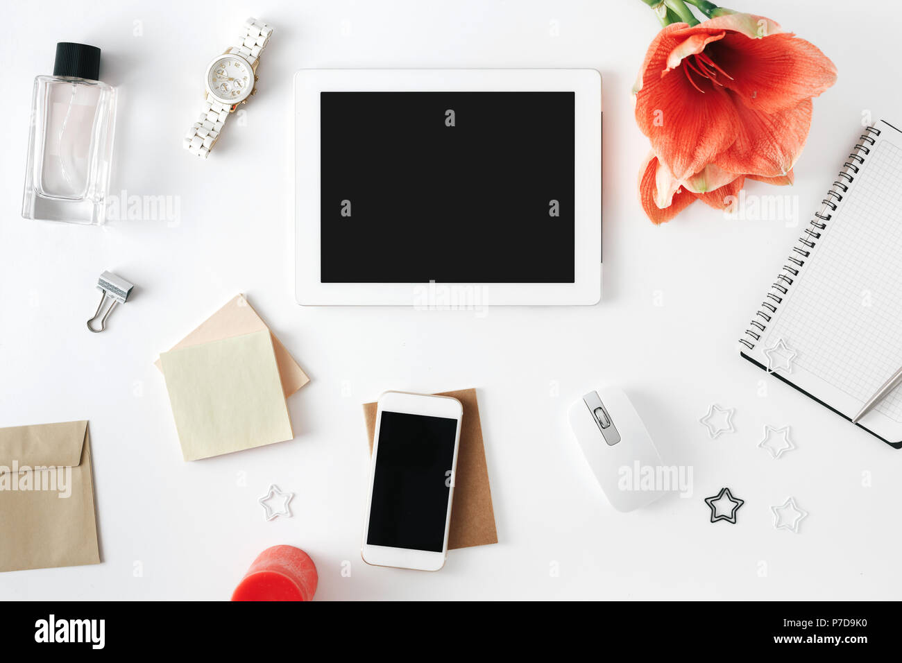 Flat Lay, Top View Office Table Desk. Feminine Desk Workspace With Flower  Amaryllis, Tablet, Notebook With Pen, Smartphone, Computer Mouse, Womens Wri