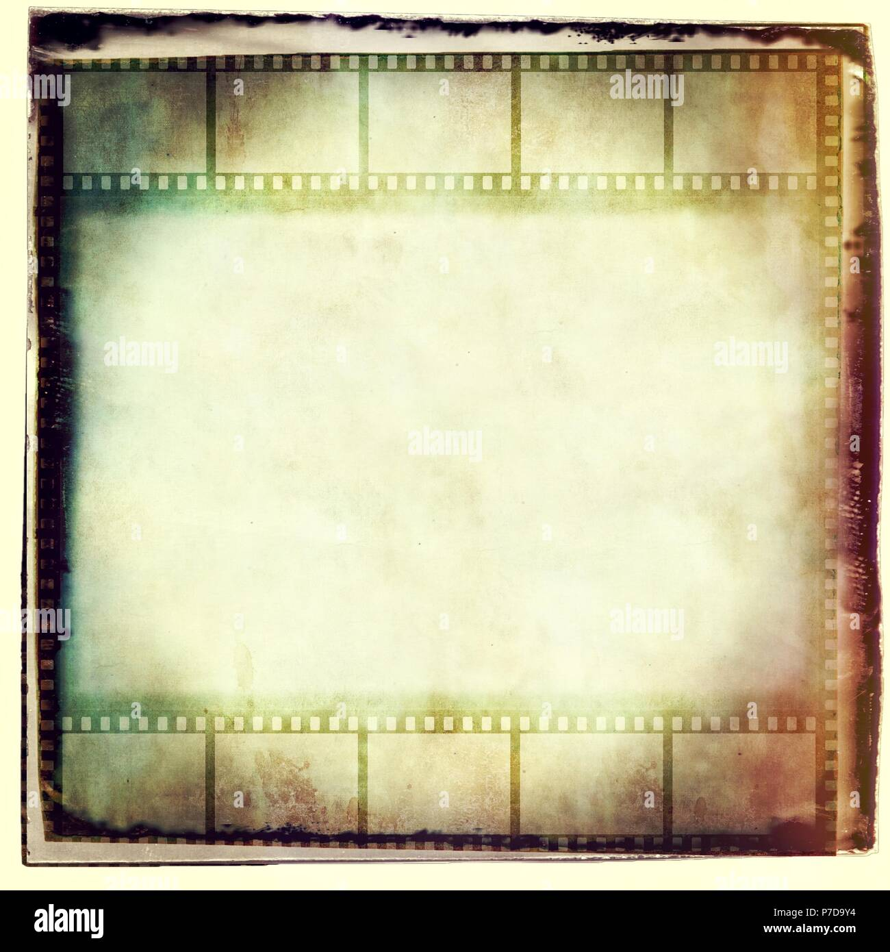Vintage film strip frame in sepia tones. - Stock Image