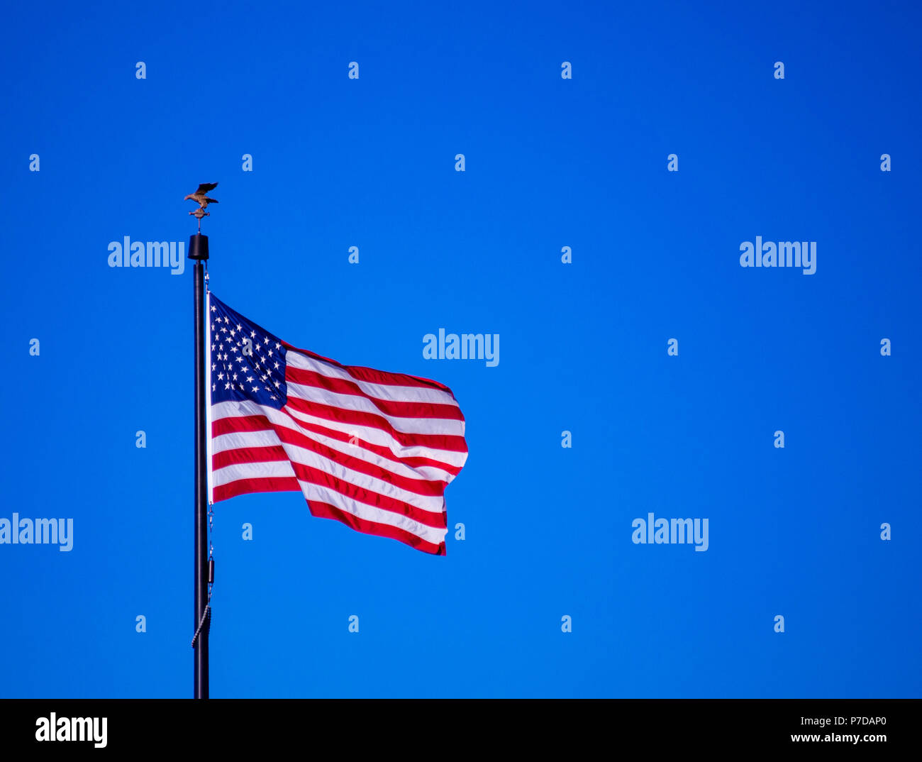 US Flag blowing in the wind - Stock Image