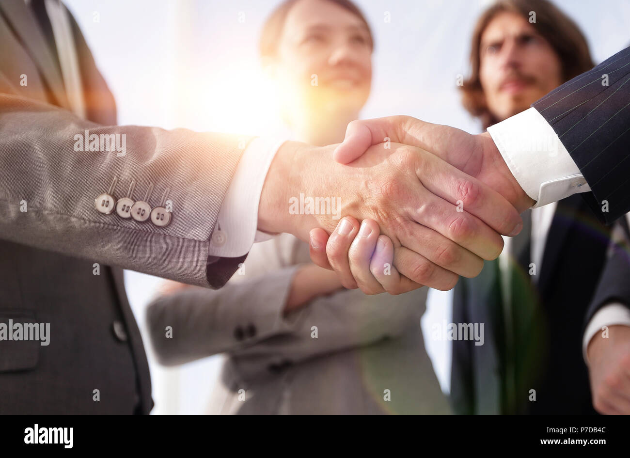 welcome and handshake business people - Stock Image