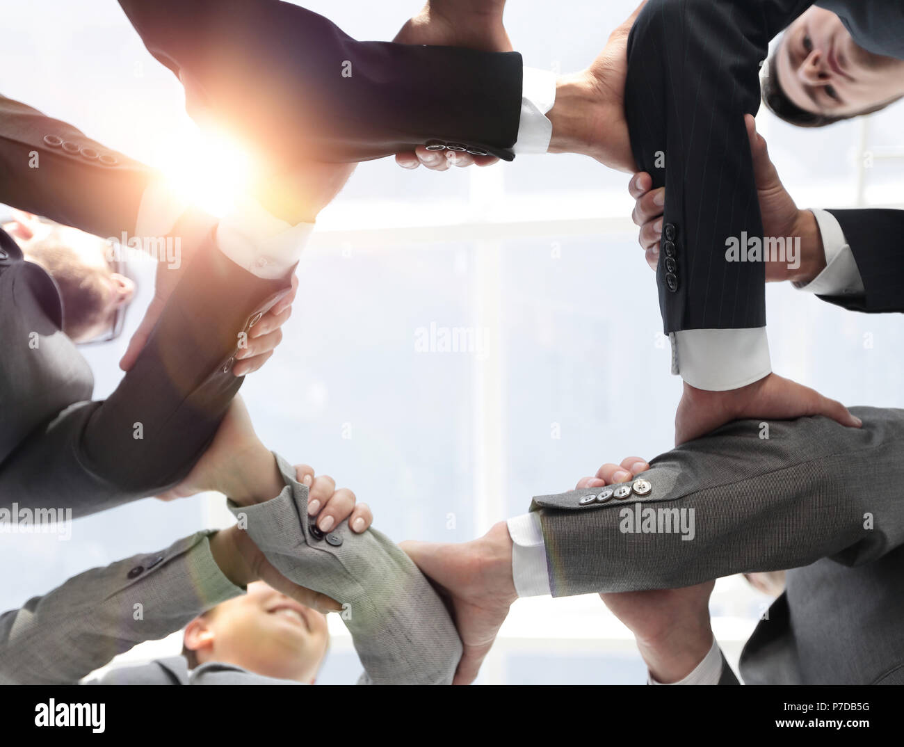 business team are taking each other's hands - Stock Image