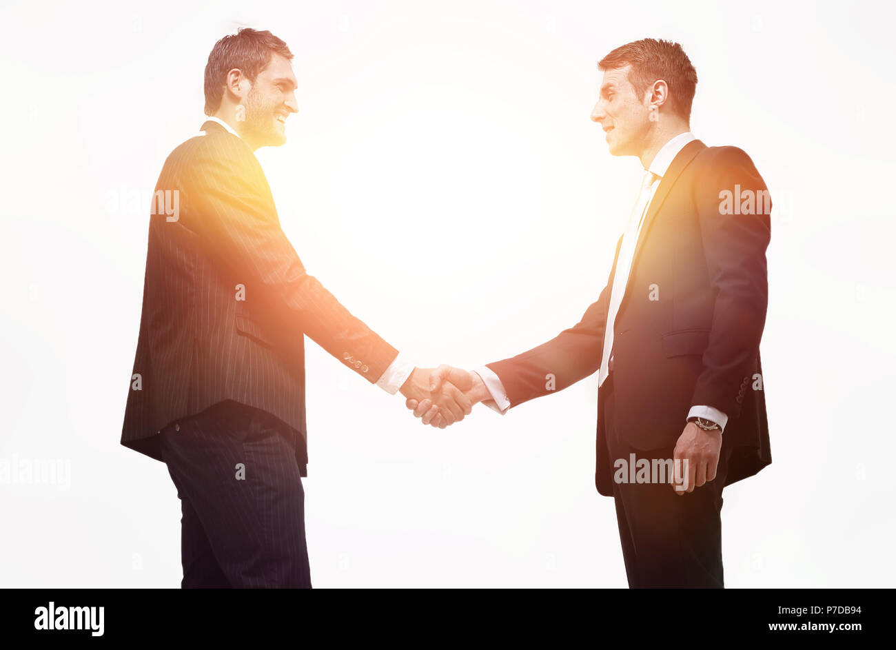 handshake business partners.isolated on a white background. - Stock Image