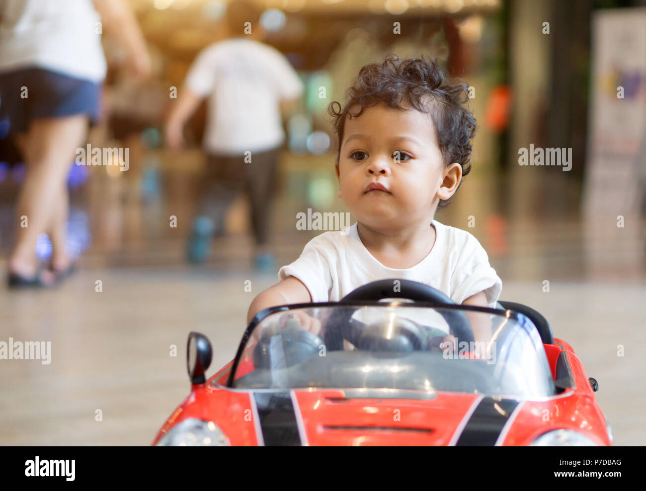Asian Baby Boy Driving In A Red Car Toy Stock Photo 211121304 Alamy