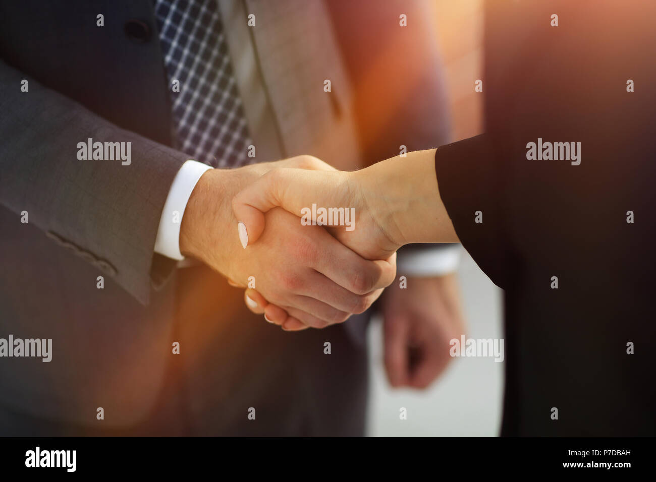 Business executives to congratulate the joint business agreement - Stock Image