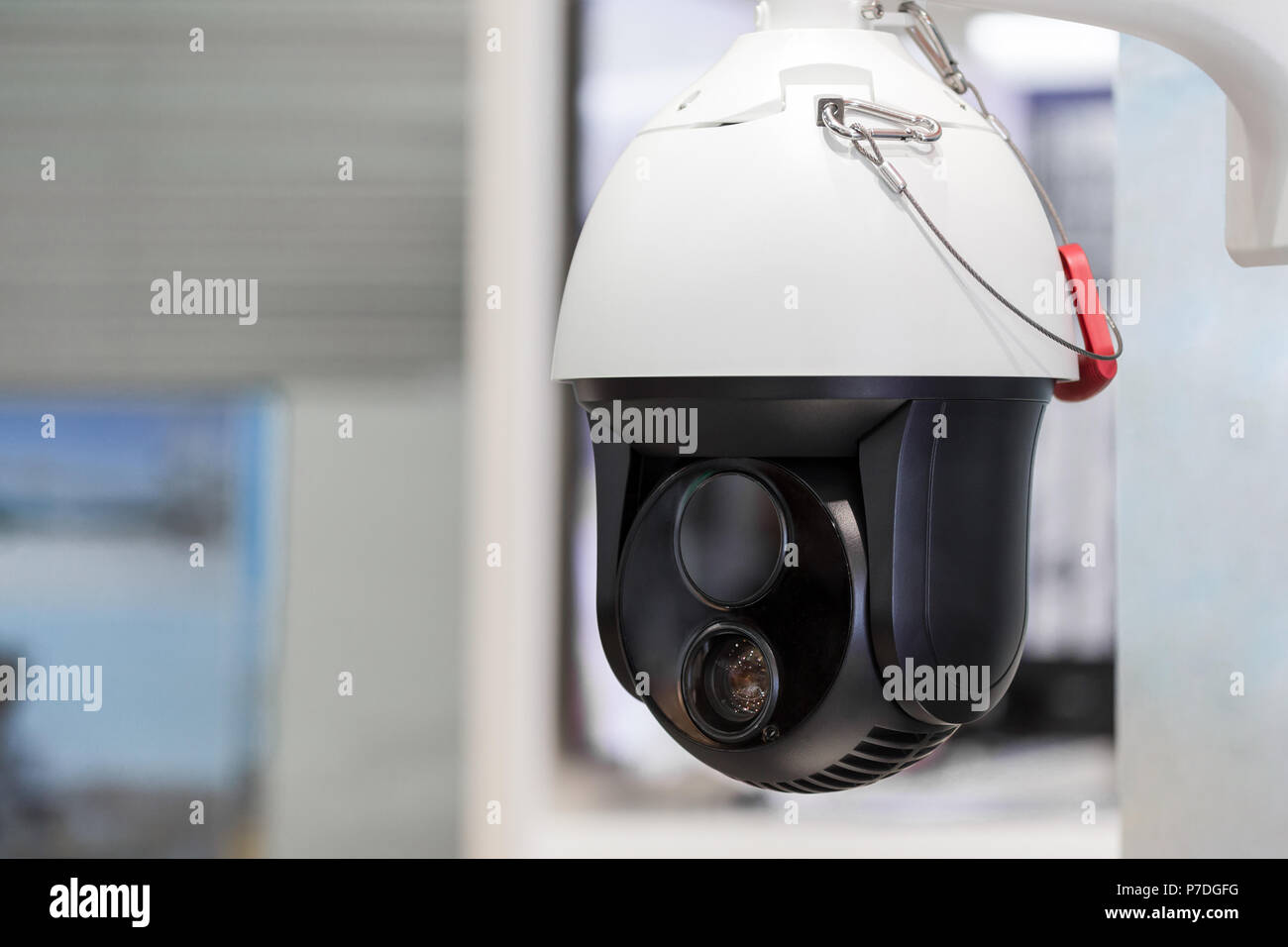 Modern motorized surveillance camera. Double wide angle moving lense. Self learning Artificial Intelligence. Tracking target. Folowing subject and dat - Stock Image