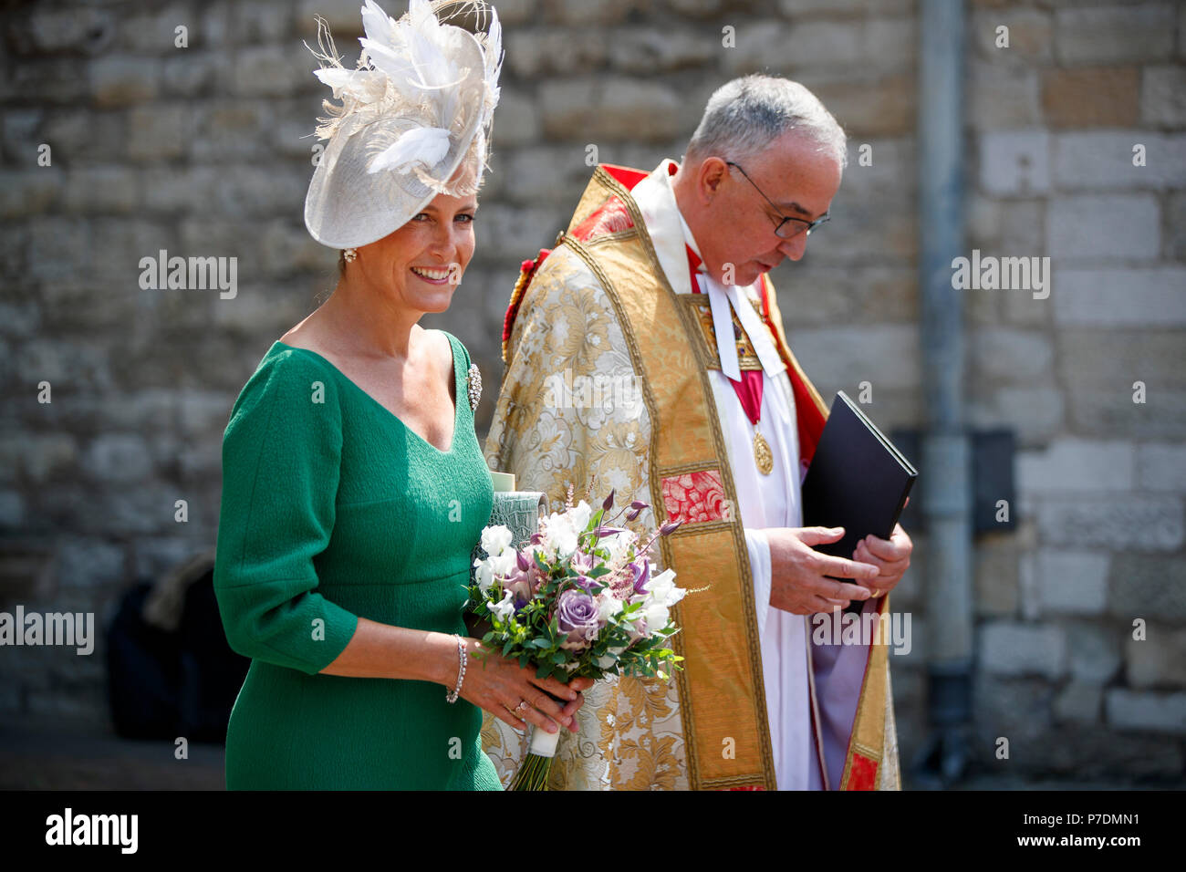 The Countess of Wessex leaves with Dean of Westminster, John Hall after attending a service to celebrate the 70th anniversary of the NHS at Westminster Abbey in London. - Stock Image