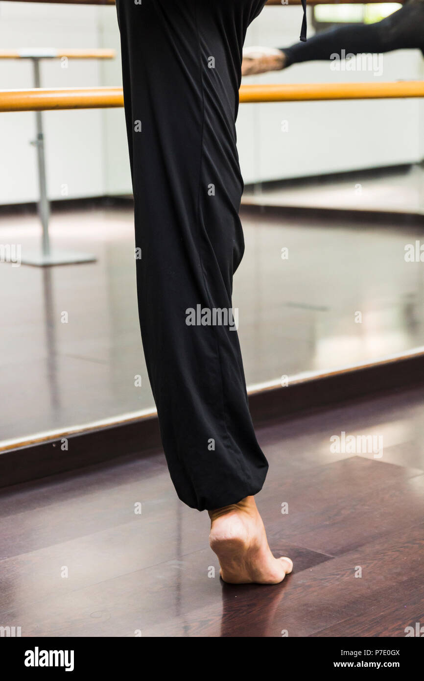 A Ballerina dancing, closeup on legs and shoes. - Stock Image