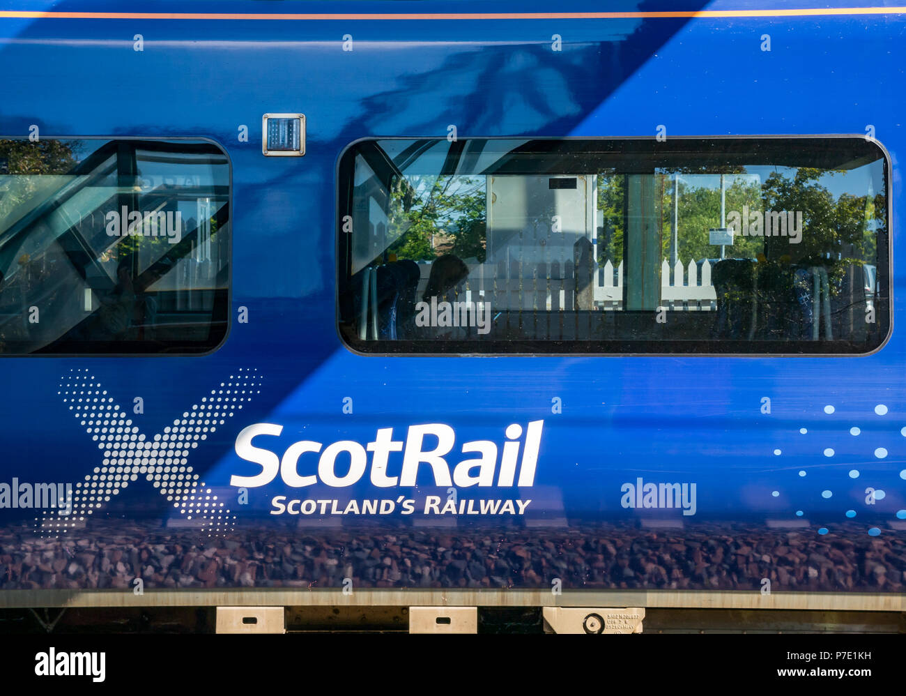 ScotRail train stopped at Drem Station with passenger silhouettes, East Lothian, Scotland, UK - Stock Image